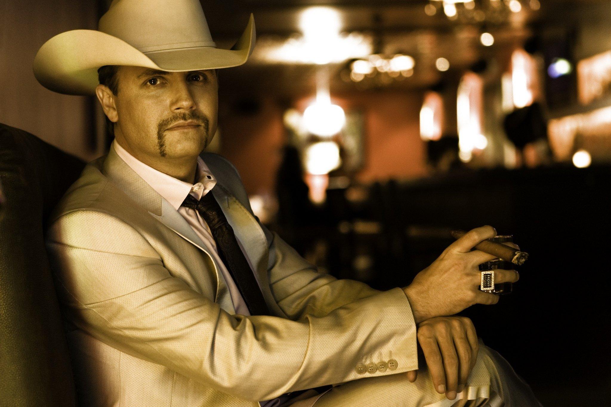 Cowboy John Rich Background Image