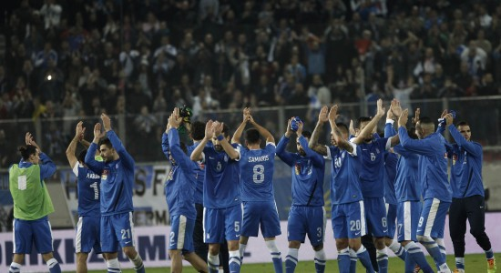 Greece's players applaud after beating Romania in their 2014 World Cup first leg qualifying playoff soccer match at Karaiskaki stadium in Piraeus