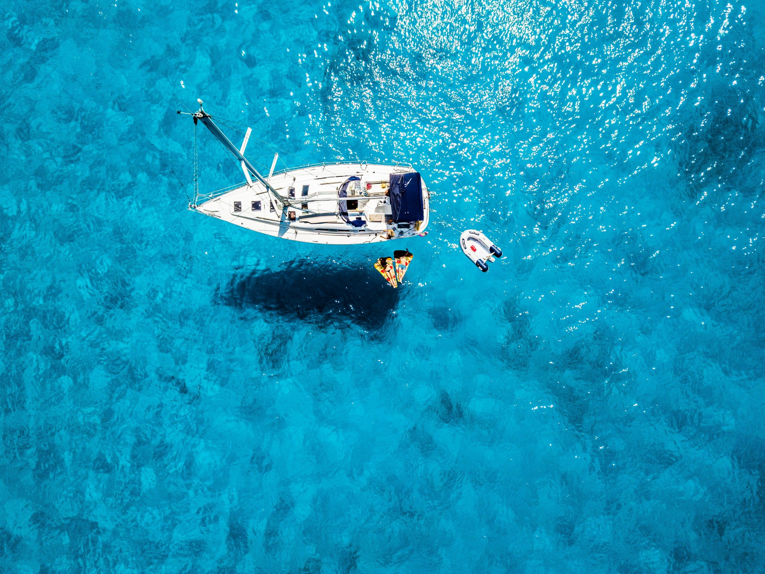A Resting Sailing Boat on Crystal Clear Water