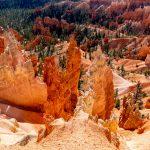 HD Orange Rocks Overlooking Green Trees Wallpaper