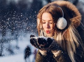 Girl in Snowy Landscape Wallpaper